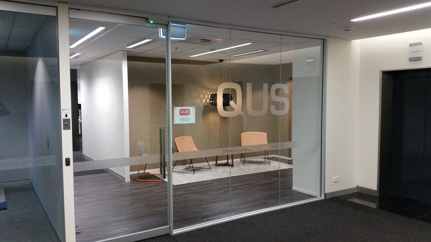 Customised company logo printed on frosted etch window film at QUS Insurance - Brisbane