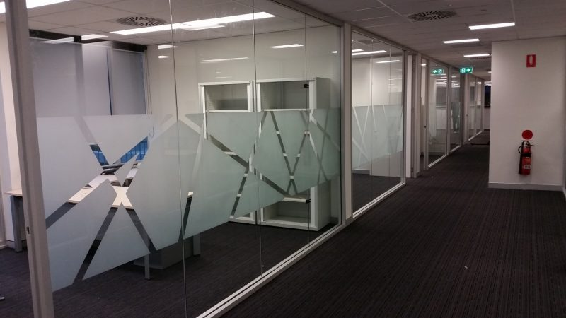Customised frosting artwork for office rooms in Brisbane