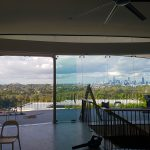 Frame-less window panels with light film applied in Brisbane home